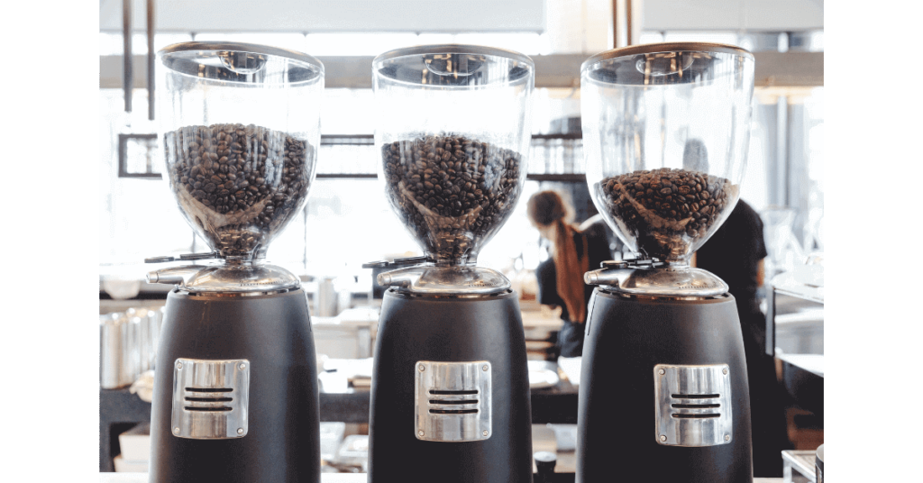 Electric counterop coffee grinders lined up in a row