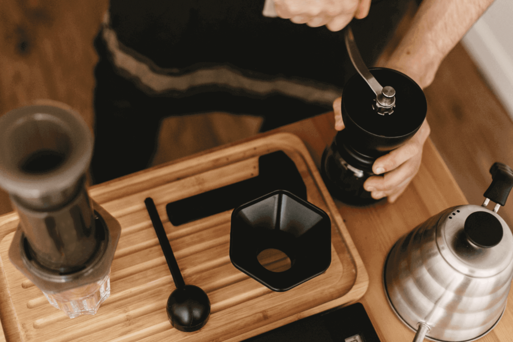 Using a manual coffee grinder to grind beans for your AeroPress