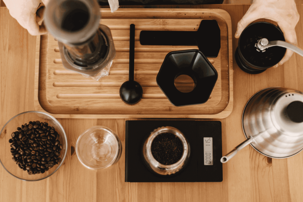 An AeroPress coffee maker setup, including grinder and coffee scale