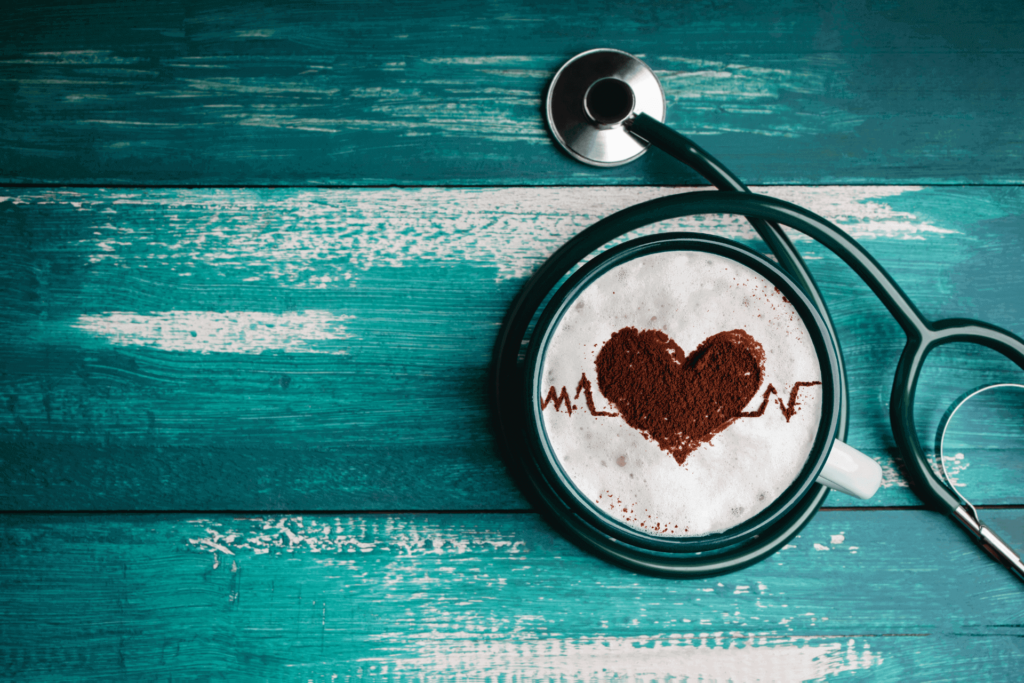 A heart in a cup of coffee, illustrating the health impacts of coffee