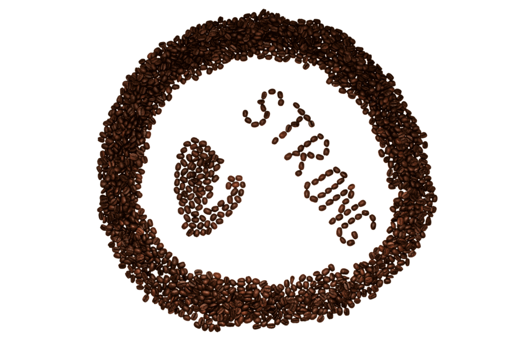 Coffee beans arranged to spell out strong